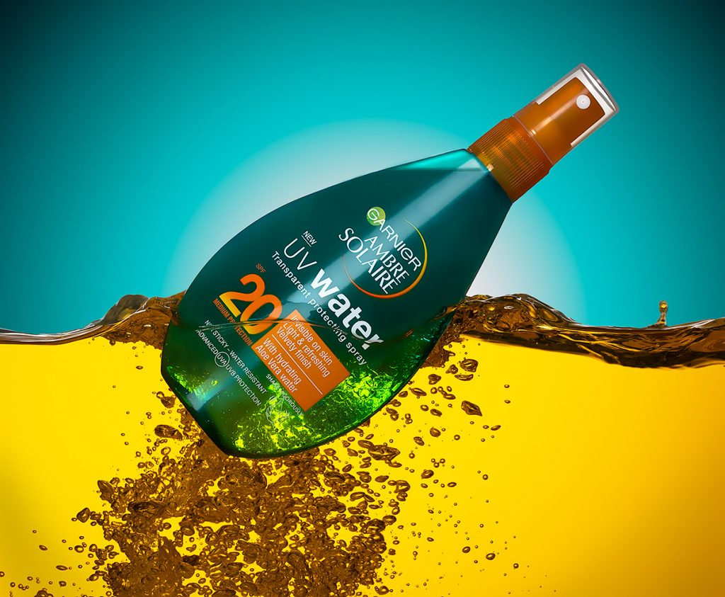 Imagehouse Studios creative product photography of Ambre Solaire UV Water spray